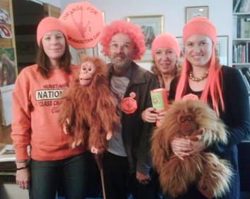 Orangutan Foundation office, Elly, volunteer Peter (in wig), Ashley and Kristina going orange!